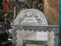 """Nakhoka Masjid"" sign in Arabic outside main entrance."