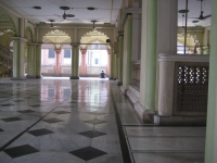 A distant worshipper on the 3rd floor