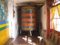 Giant prayer wheel about 8 feet tall.